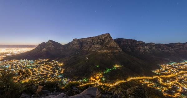 View of a mountain with the city of Cape Town below, lit up at night