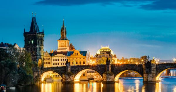 View of the Charles Bridge in Prague lit up at night