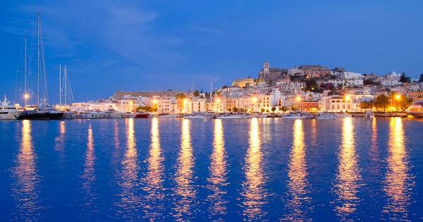 View of the Ibiza coastline lit up at night-time