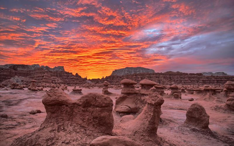 View of rock formations under a dramatic sky at Goblin Valley