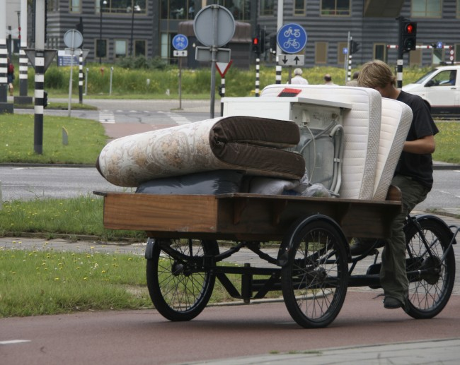 Mattresses being transported by bike in Amsterdam