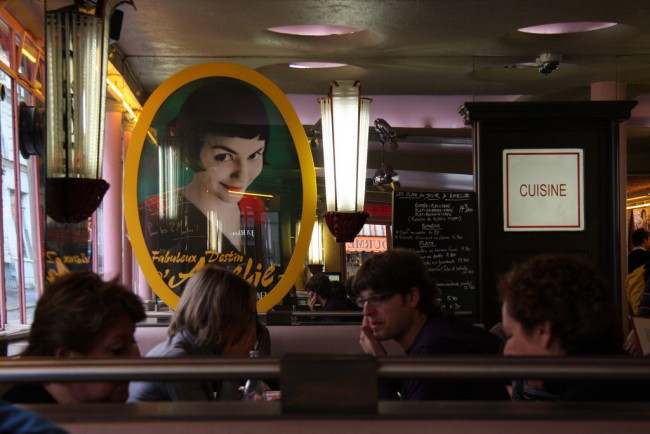 A poster of the film Amelie in a cafe