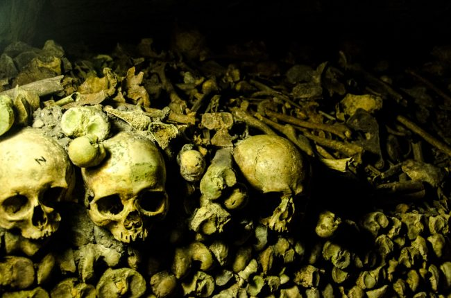 In the Catacombs of Paris by Chad Goddard. Photograph via Flickr CC