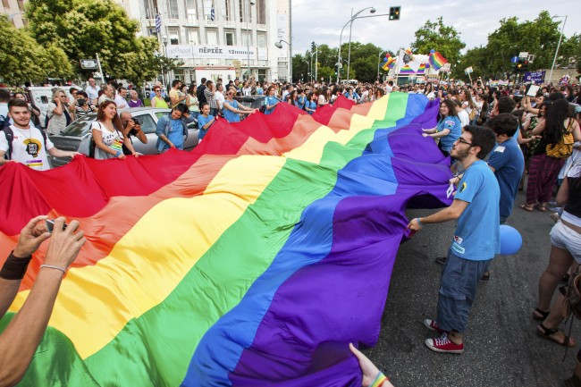 Participants with the rainbow flag, the symbol of the gay rights